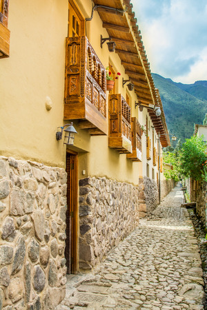 OLLANTAYTAMBO, PERU - Streets of the small, medieval city of Ollantaytambo, with old houses on Andes Mountains