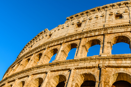 Sunset colors on Colosseum, an elliptical amphitheater in the center of Rome, Italy.