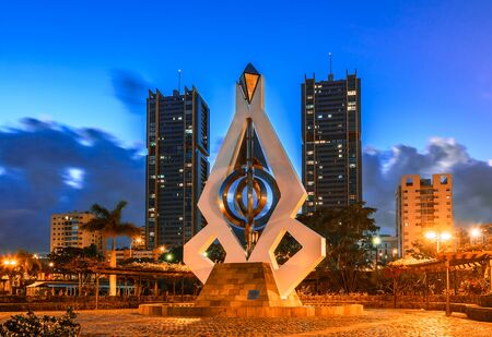 Santa Cruz de Tenerife, Canary Islands, Spain - February 20, 2018: Night view of Torres de Spain and Wind Chime Sculpture by Cesar Manrique