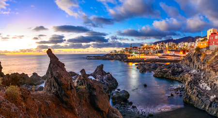 Puerto de Santiago city, Tenerife, Canary island, Spain: Beautiful sunset view of Puerto de Santiago over the rocks and water Stock Photo