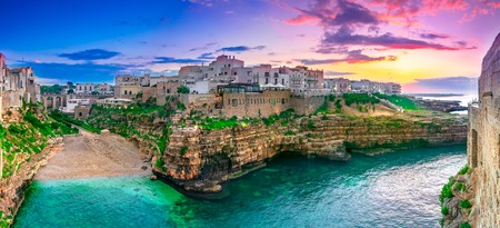 Polignano a Mare, Puglia, Italy: Sunset at Cala Paura gulf with Bastione di Santo Stefano and Lama Monachile beach in background, Apulia, Italy, province of Bari Imagens