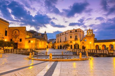 Matera, Italy, Vittorio Veneto square: Night view of the St. Domenico church and Materdomini church over the  Hypogeum ruins in the city centre Reklamní fotografie