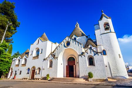 Alberobello, Puglia, Italy: The Church of St. Antonio built with trullo conical roofs, in a beautiful day, Apulia Reklamní fotografie