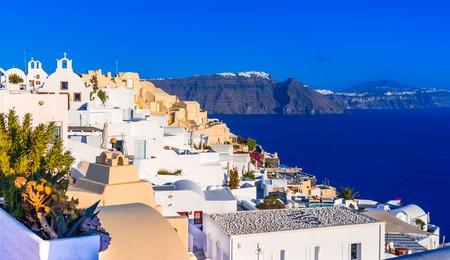 Oia town, Santorini island, Greece: Traditional and famous white houses and churches over the Caldera, Aegean sea. Reklamní fotografie