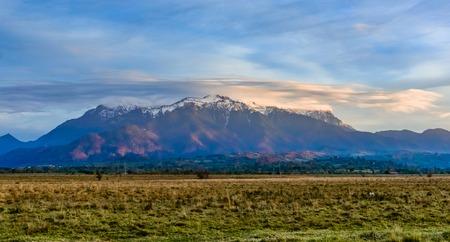 Bucegi mountains, Brasov, Romania: Landscape view in the sunset light of the snowy, Bucegi mountain, peaks, Carpathians mountains range, Romania.
