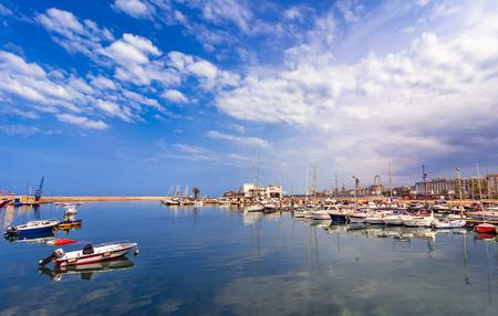Bari, Italy, Puglia: Beautiful landscape with fishing boats, yaght and blue sea against the sky. Apulia Reklamní fotografie