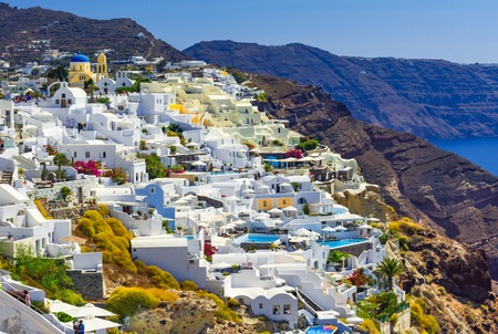 Fira, Santorini island, Greece: Traditional and famous white houses over the Caldera, Aegean sea. Reklamní fotografie