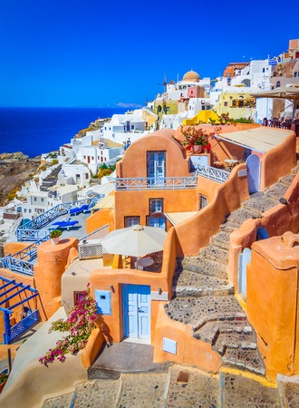 Oia, Santorini island, Greece: Classical view over in Oia with traditional and famous houses and churches over the Caldera, Aegean sea.