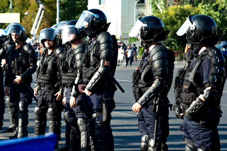 Bucharest, Romania - 10 August 2018: Riot police prepared to supress the manifestation during the protest of Diaspora when tens of thousands of protesters have rallied in cities across Romania against the way Romania is governed