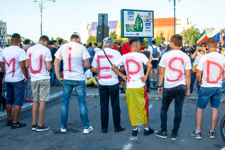 Bucharest, Romania - 10 August 2018: People displaing a message to Social Democrats at the Diaspora protest against the way Romania is governed by Social Democrats