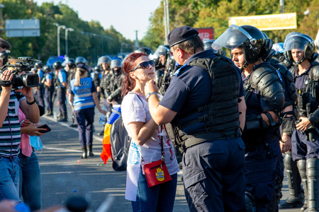 Bucharest, Romania - 10 August 2018: A woman speaking with riot police during the protest of Diaspora thousands of protesters have rallied in cities across Romania against the way Romania is governed
