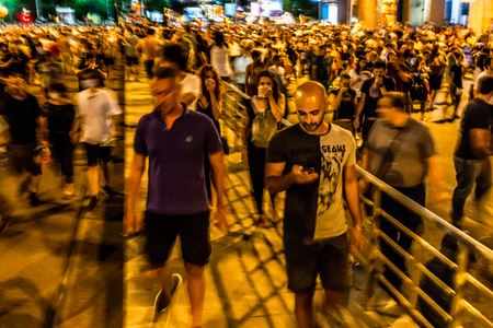 Bucharest, Romania - 10 August 2018: People getting away from the tear gas Thousands of protesters have rallied in cities across Romania against the way Romania is governed by the Social Democrat-PSD