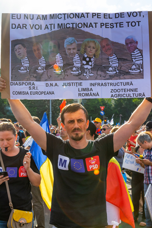 Bucharest, Romania - 10 August 2018: Young man protesting at the Diaspora protest against the way Romania is governed by Social Democrats