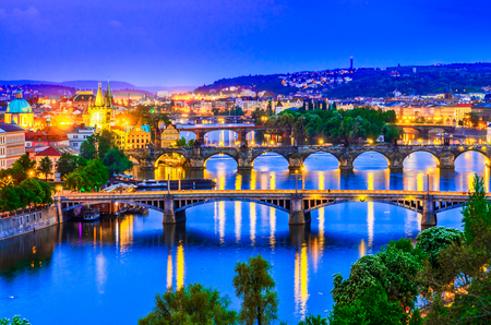 Prague, Czech republic: Night view over the Vltava river and its bridges at sunset