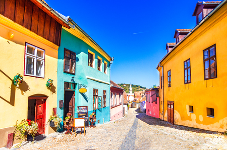 Sighisoara, Romania: Famous stone paved old streets with colorful houses in the medieval city-fortress Sighisoara,Transylvania, Europe