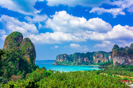 Railey beach, Krabi, Thailand: Beautiful overview over the palm trees with blue water and limestone cliffs Reklamní fotografie