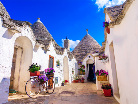 Alberobello, Puglia, Italy: Typical houses built with dry stone walls and conical roofs, in a beautiful day, Apulia