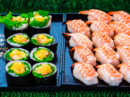 Sushi rolls japanese delicacy. Japanese traditional food from rice and fish or sea food.  A set of delicious delicacies in a day market in Thailand, Asia Reklamní fotografie