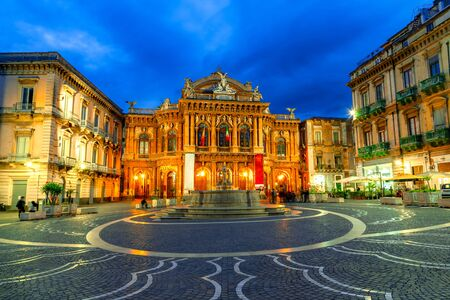 Catania, Sicily island, Italy: The facade of the theater Massimo Bellini and the fountain in the night lighting