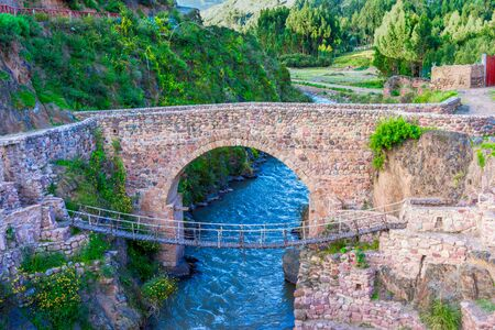 Checacupe, Cusco, Peru: The Colonial Bridge of Checacupe one of the most incredible attractions of this place, and the Inca Bridge built of straw - Queshua Chaca