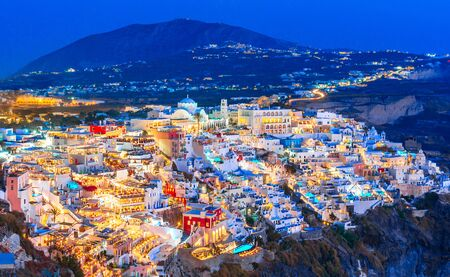 Fira, Santorini island, Greece. Overview of the cliffside town of Thira,Fira, with the traditional and famous white houses over the Caldera, Aegean sea Reklamní fotografie