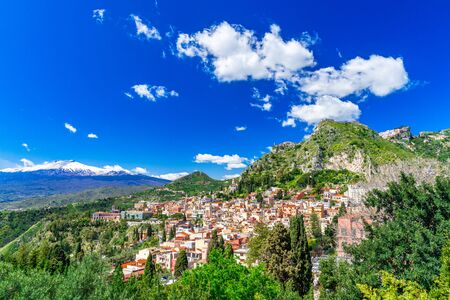 Taormina, Sicily, Italy: Panoramic view from the top of the Greek Theater, Giardini-Naxos with the Etna and Taormina, in a beautiful day. Reklamní fotografie