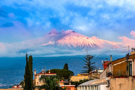 Taormina, Sicily, Italy: Panoramic view of the Etna seen over the city, in the sunrise lights Reklamní fotografie