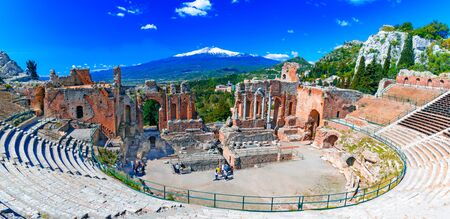 Taormina, Sicily, Italy: The Greek Theater of Taormina with smoking Etna volcano in background, in a beautiful day of summer Reklamní fotografie