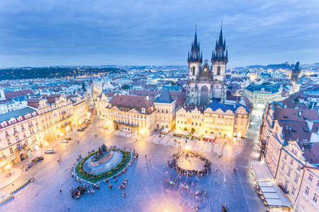 Panoramic view to Tyn church and Jan Hus memorial on the old town square in the evening Prague