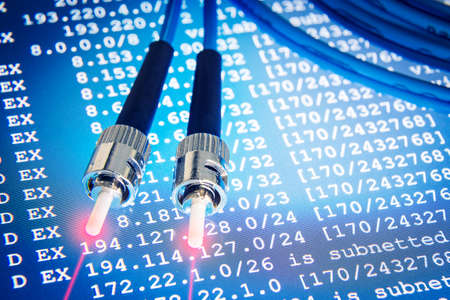 Fiber optic cables for backbone lines on blue network background Stockfoto