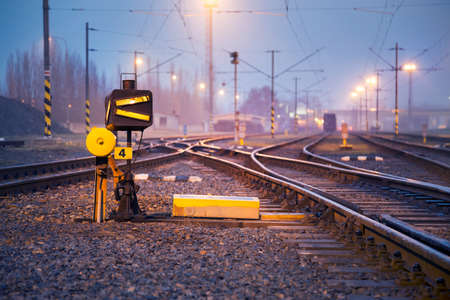 Railway track switch. Freight train station in the evening Imagens