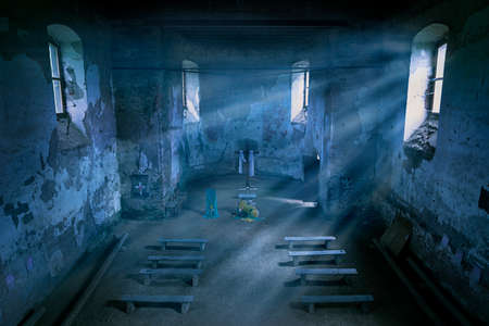 Mysterious church interior with moonlight beams in the night.