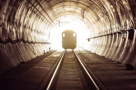 Train in railway tunnel.