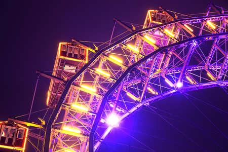 Lighting Ferris wheel in the night - Vienna Prater / Wiener Riesenrad in Austria Stock Photo
