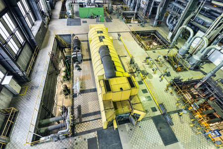 Coal power plant. Industry interior with turbine, electric generator. Production of electric energy