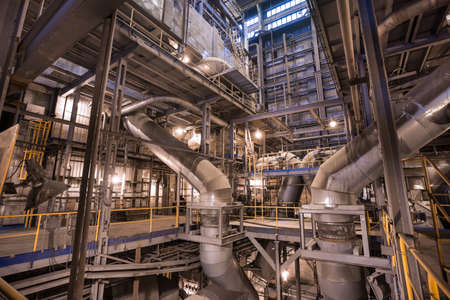 Interior of coal power plant. Pipelines in boiler room
