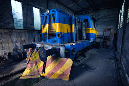 Abandoned locomotive in depot of old mine