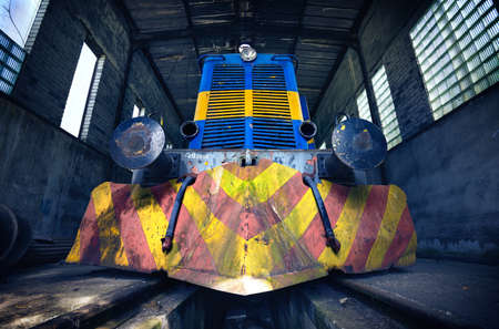 Abandoned diesel locomotive in depot of old mine. Bottom view