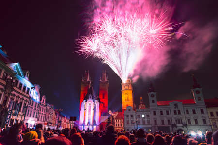 Crowd of people watching New Year fireworks in historic city center of Hradec Kralove, Czech Republic
