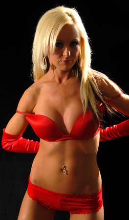 sexy blonde woman removing bra photo
