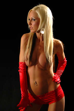 sexy blonde topless woman in red gloves photo