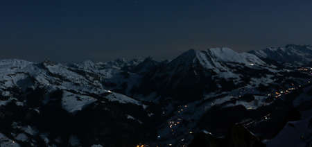 alpine landscape with snow covered mountains at night
