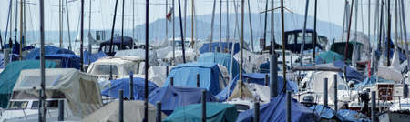 panoramic view of boats and masts in a harbor