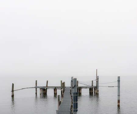 small pier at a lakeshore