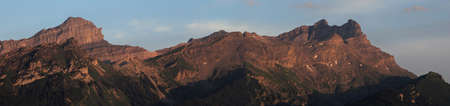 panoramic view of a mountain range at dusk