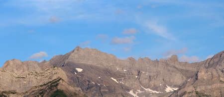 panoramic view of a mountain range and clouds