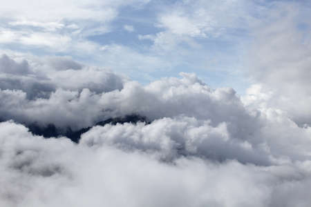 view of a mountain obscured by clouds