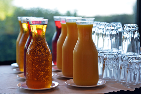 Carafes of various fruit juice and glasses
