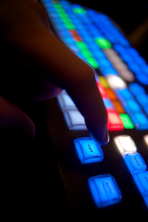 Finger about to press cut on a video switcher Stock Photo