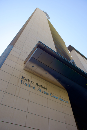 PORTLAND, OREGON JULY 20 2016, Looking up at a corner of the the Mark O. Hatfield United States Courthouse, featuring the signage on the building.